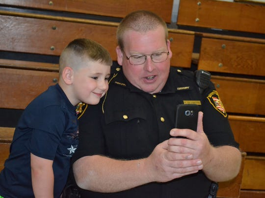 "Sandusky County Sheriff's Deputy Eric Arquette takes a selfie with student Garrett Allen during ""Chillin' with a Cop."" Arquette said events like this help forge important bonds between students and police officers."