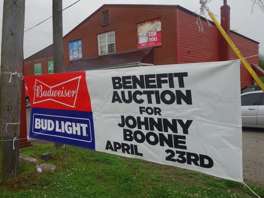 Sign for Johnny Boone fundraiser.