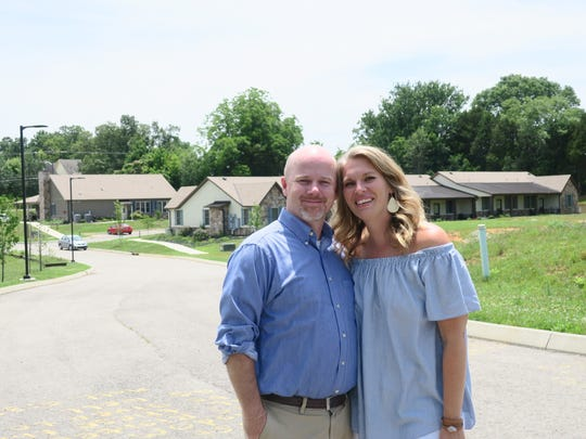 Restoration House co-founders Daniel and Mandy Watson stand at The Village, a gated apartment complex for single mothers and their children.
