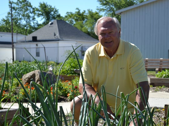 Dave Mehl tends this plot of onions at the Mosie Nesbit Johnson Community Garden. The garden is filled with a variety of produce, including tomatoes, onions and peppers.