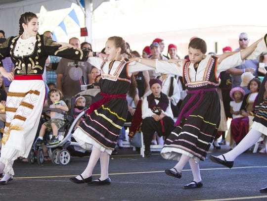 The Eliopoula dance group takes the stage during the