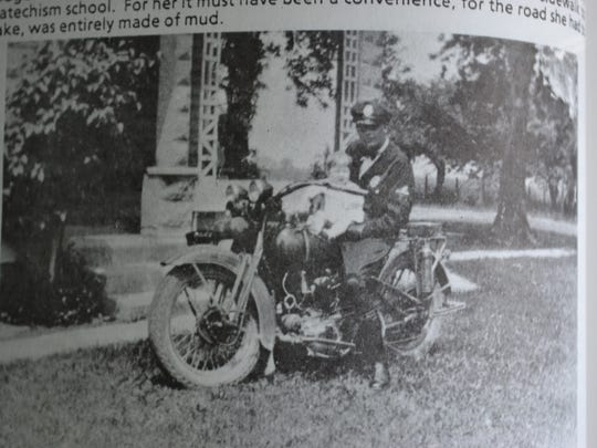 """This photo from the book, """"Reflections of Rocky Ridge, OH, 1830 – 1989"""" depicts lifelong resident LaVerne Sprague with her father, Ervin Fillmore, the first motorcycle cop in Ottawa County."""