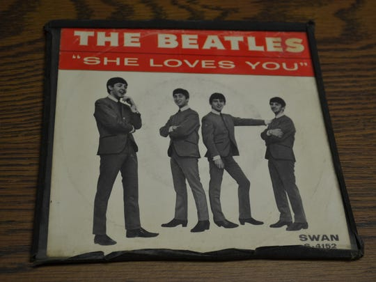 """Chuck Grindstaff stills owns the first Beatles record he bought – this copy of """"She Loves You."""" His early interest in the group turned into a passion that has made him a world-respected expert Beatles historian."""