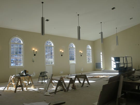 Light filters through windows of the sanctuary being