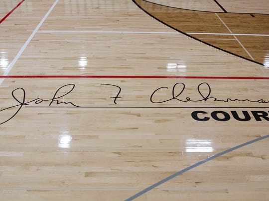 The signature of John Chekouras on the court at Homestead High School
