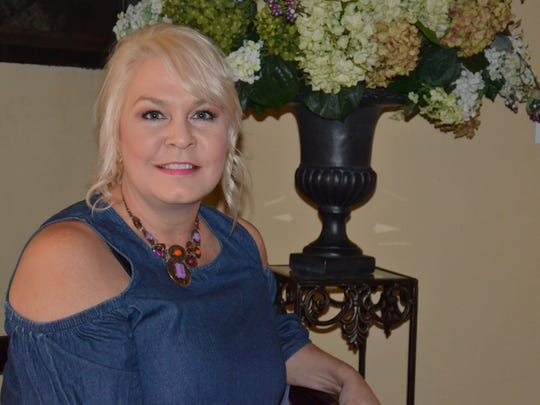 Kelli Weaver owns Kelli & Company Estate Sales and The Dressy Painter out of her Genoa home. Plans are in the works to run the businesses out of a not-yet-constructed auction house on the outskirts of town.