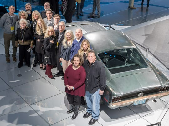 Samantha and Sean Kiernan (with Molly McQueen) and the whole family with the '68 Mustang Bullitt.