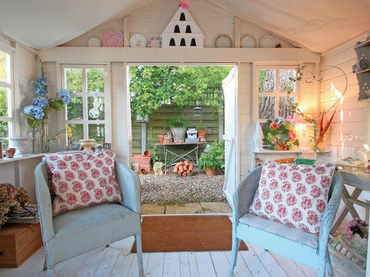"Floral stylist Anne Wells' quaint shed in St. Albans, Hertfordshire, England, is featured in Erika Kotite's first book, ""She Sheds: A Room of Your Own."""