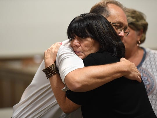 Cindy Coxie, the mother of one of Todd Kohlhepp's victims, hugs a family member after testifying on Wednesday, July 11, 2018.