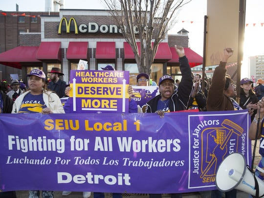 Workers rally for a $15 an hour wages outside a McDonald's restaurant in Detroit in August 2017.