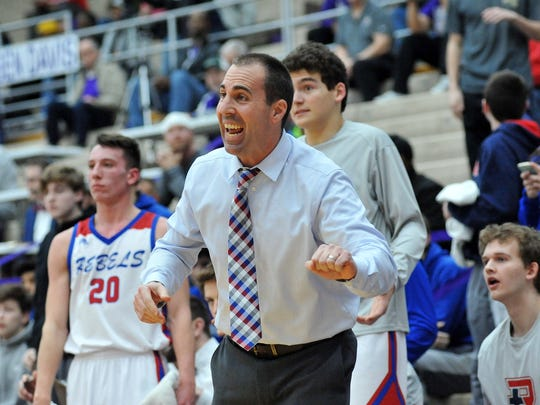 Roncalli coach Michael Wantz tries to get instructions to his players on the court.