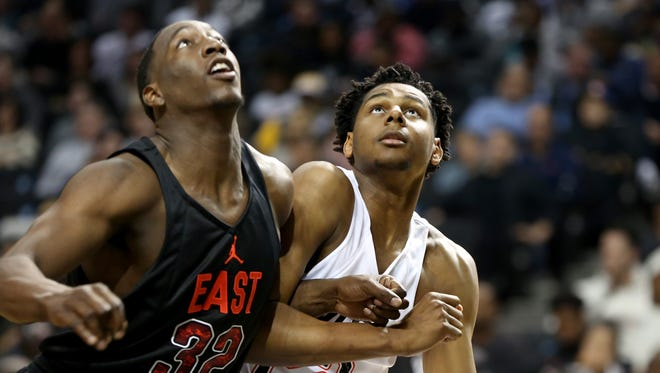 The East team's Marques Bolden, right, works against UK signee Bam Adeayo, left, during the Jordan Brand Classic on Friday, April 15, 2016 in Brooklyn, NY.