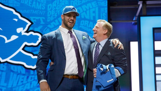 Taylor Decker laughts with NFL commissioner Roger Goodell after being selected by the Lions.