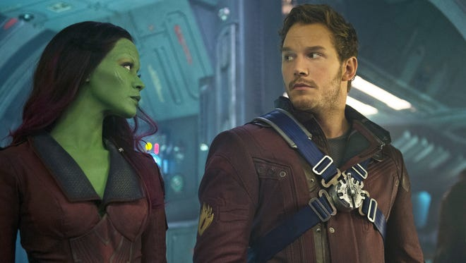 "Gamora (Zoe Saldana) and Peter Quill/Star-Lord (Chris Pratt) in a scene from the motion picture ""Guardians of the Galaxy."""