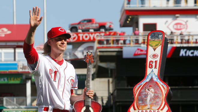 Sep 23, 2017; Cincinnati Reds starting pitcher Bronson Arroyo waves to the crowd after receiving a custom-made guitar from the Reds during a tribute honoring his career before a game with the Boston Red Sox at Great American Ball Park.