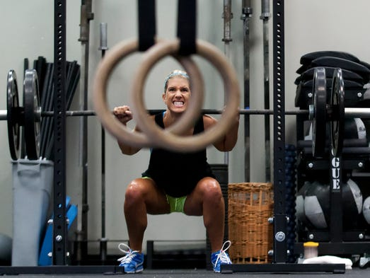 Jada Fleming works out Wednesday during a Crossfit class at Around The Clock Fitness in Fort Myers.