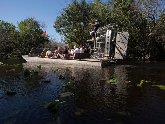 An airboat tour out Cooperstown Airboat Rides on Tamiami Trail in Dade County heads off into the Everglades.  Water levels are rising as water from Lake Okeechobee are being pushed south.