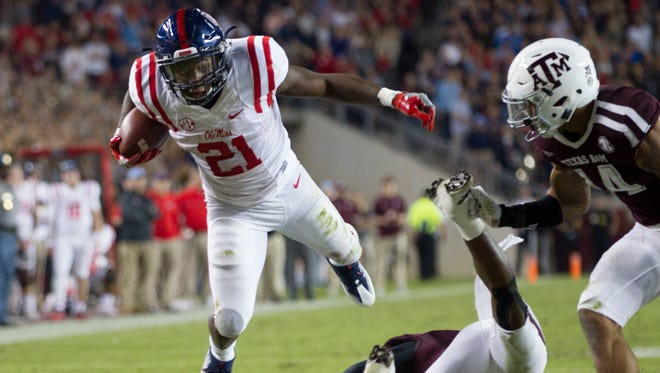 Mississippi running back Akeem Judd (21) jumps over a Texas A&M defender during the first quarter of their game Saturday in College Station.