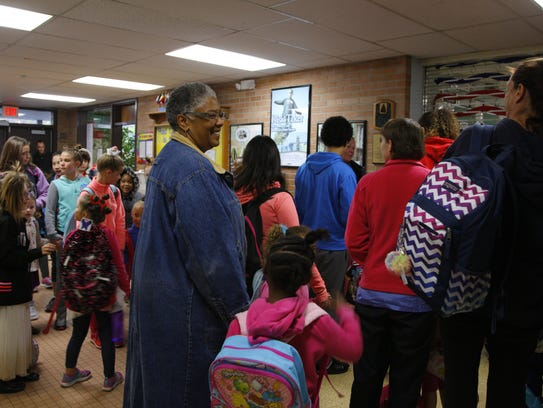 Students and parents gather before the school day begins,