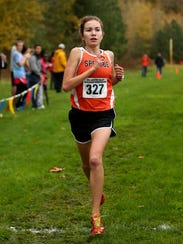 Sprague's Ginger Murnieks finishes first in the Greater Valley Conference championship girls 5K race at the Crystal Lake Sports Park in Corvallis on Oct. 26, 2016.