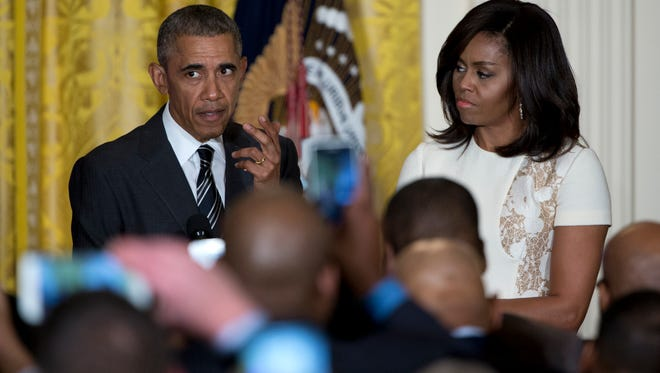 President Barack Obama speaks as he and first lady Michelle Obama host a reception celebrating African American History Month in the East Room of the White House in Washington, Thursday, Feb. 18.
