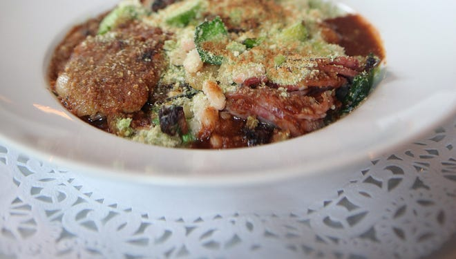 Cassoulet is duck confit, garlic sausage, bacon lardon, lamb and gratin herb bread crumb served at Le Chateau restaurant in South Salem.