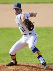 Garrett Bell delivers a pitch for Lansing against Avon