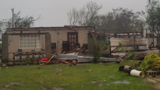 Typhoon Dolphin caused damage to homes and schools, and left residents without power when it rolled over Rota on May 15.