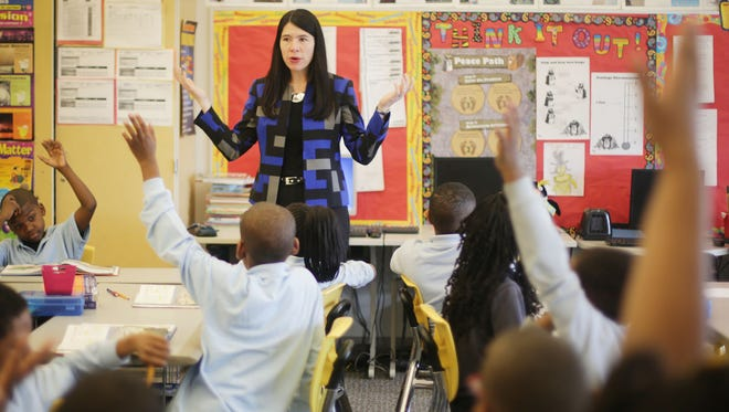 Alycia Meriweather, 42, of Detroit is the new interim superintendent of Detroit Public Schools. She visits a fourth grade classroom of a former colleague she taught with, Ricardo Washington and his students  at Golightly Education Center. She tells the students she too went to fourth grade at the same school.