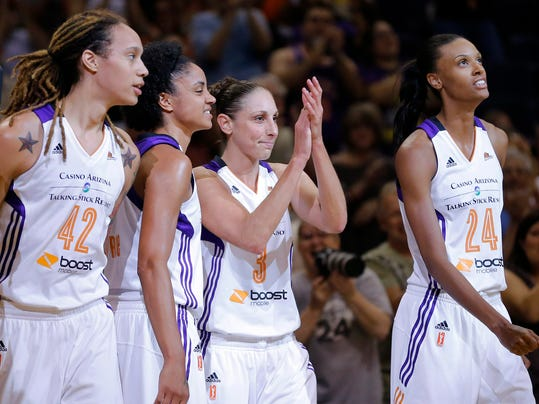 Phoenix Mercury forward Diana Taurasi (3) acknowledges the crowd as they cheer her after she became the No. 2 WNBA career scorer, during the second half of a WNBA basketball game against the Chicago Sky, Wednesday, July 2, 2014, in Phoenix. From left are Brittney Griner (42), Candice Dupreee and DeWanna Bonner (24). (AP Photo/Matt York)