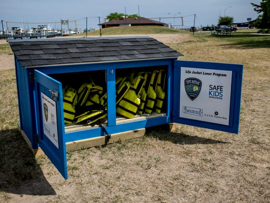 Life jackets are seen in a community bin Wednesday,