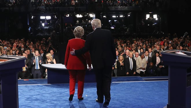 Republican presidential nominee Donald Trump (R) and Democratic presidential nominee Hillary Clinton (L) shake hands after the Presidential Debate at Hofstra University on September 26, 2016.