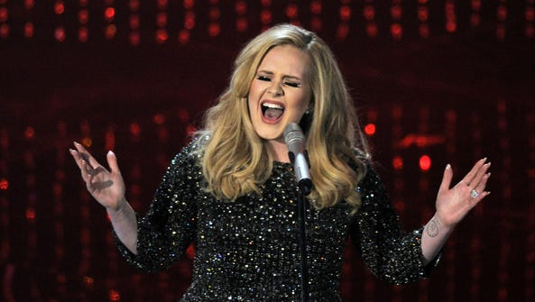 """Adele's """"Hello"""" single has become the first song to"""