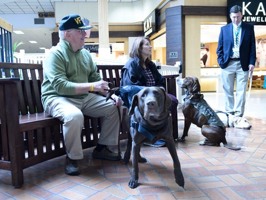 Retired U.S. Navy  Capt. Craig Hoffman, left, brought his therapy dog to the Push-Up Challenge to support veterans Wednesday, November 2, 2016 at Chambersburg Mall. The event is designed to bring awareness to the increase in suicides among members of the military. Capt. Hoffman's dog is a part of the Operation Save-a-Vet Save-a-Pet program.