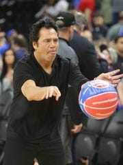 Pistons owner Tom Gores passes a ball after the Pistons' 105-101 loss to the Wizards in the final game at the Palace of Auburn Hills on April 10, 2017.