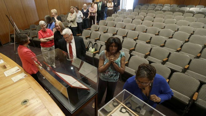 People line up in June to see a duplicate of the 13th Amendment at an exhibit in Raleigh, N.C., on abolishing slavery.
