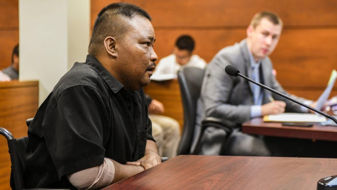 Guam police officer Constantino Faustino Jr. answers inquiries, from Superior Court Judge Benjamin Sison Jr., on the amount of his income during his arraignment hearing at the Superior Court of Guam in Hagåtña on Wednesday, Jan. 10, 2018.
