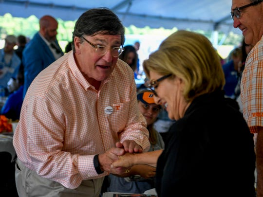 Tennessee candidates for governor Diane Black, right, and Craig Fitzhugh, left, shake hands after a breakfast at the 30th Milan no-Till Crop Production Field Day at AgResearch and Education Center in Milan, Tenn., Thursday, July 26, 2018.