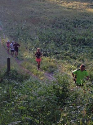 Runners tackle trails in Mendon Ponds Park. The Mighty Mosquito, a 99-mile trail race and relay will be held in the park Aug. 8 and 9.