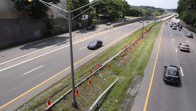 A damaged section of guardrail is set off by traffic cones along the Cross County Parkway in Mount Vernon  after a two-car accident sent the guardrail across the parkway and closed the road for nearly an hour, July 17, 2015. No one was injured and traffic began moving again after the rail was moved back into the median.