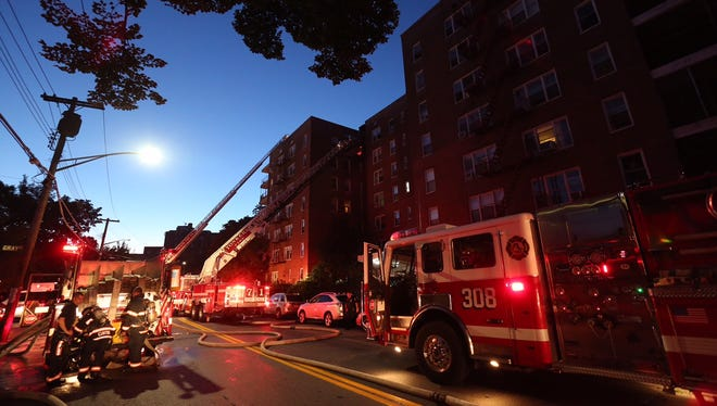 Yonkers Fire Department work at a three alarm fire at 200 Valentine Lane. in Yonkers early Friday morning, Aug. 28, 2015.