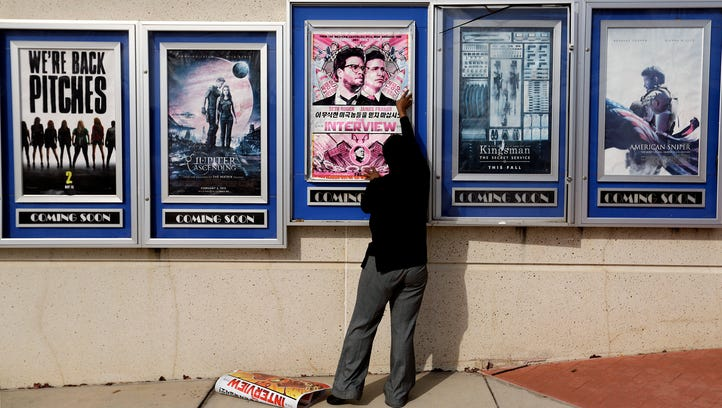 """A poster for the embattled movie """"The Interview"""" is"""