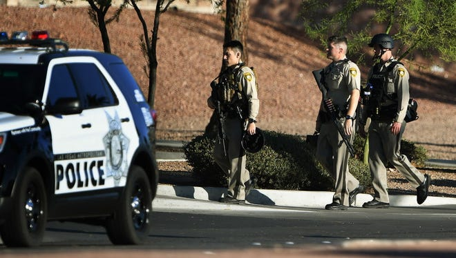 Police return to their vehicles after patrolling around the Mandalay Hotel when a gunman killed at least 58 people and wounded more than 500 others when he opened fire on a country music concert in Las Vegas, Nevada on Oct. 2, 2017.