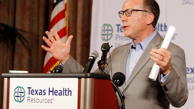 Texas Health Presbyterian Hospital Chief Clinical Officer Dr. Daniel Varga answers questions about a health care worker  who provided hospital care for Thomas Eric Duncan who contracted Ebola, during a press conference at the hospital, Sunday, Oct. 12, 2014, in Dallas.