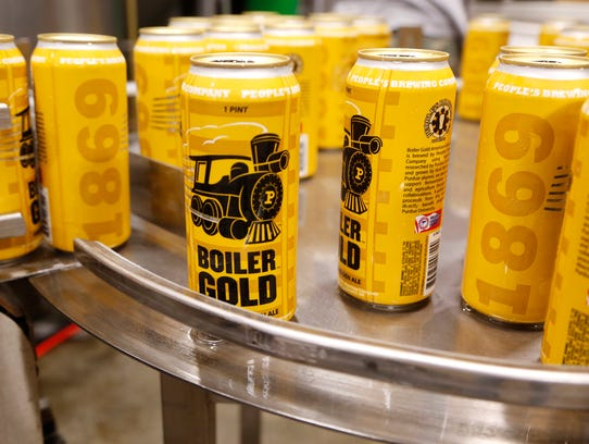 Boiler Gold American Ale rolls off the canning lineThursday,