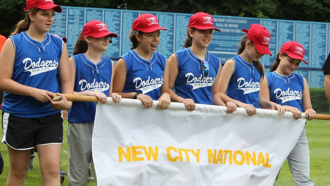 The New City National Dodgers participate in the opening ceremony of the 54th annual Tournament of Champions, hosted by the Haverstraw Little League at Leo Laders American Legion Post 130 Memorial Field in Haverstraw, June 14, 2014.