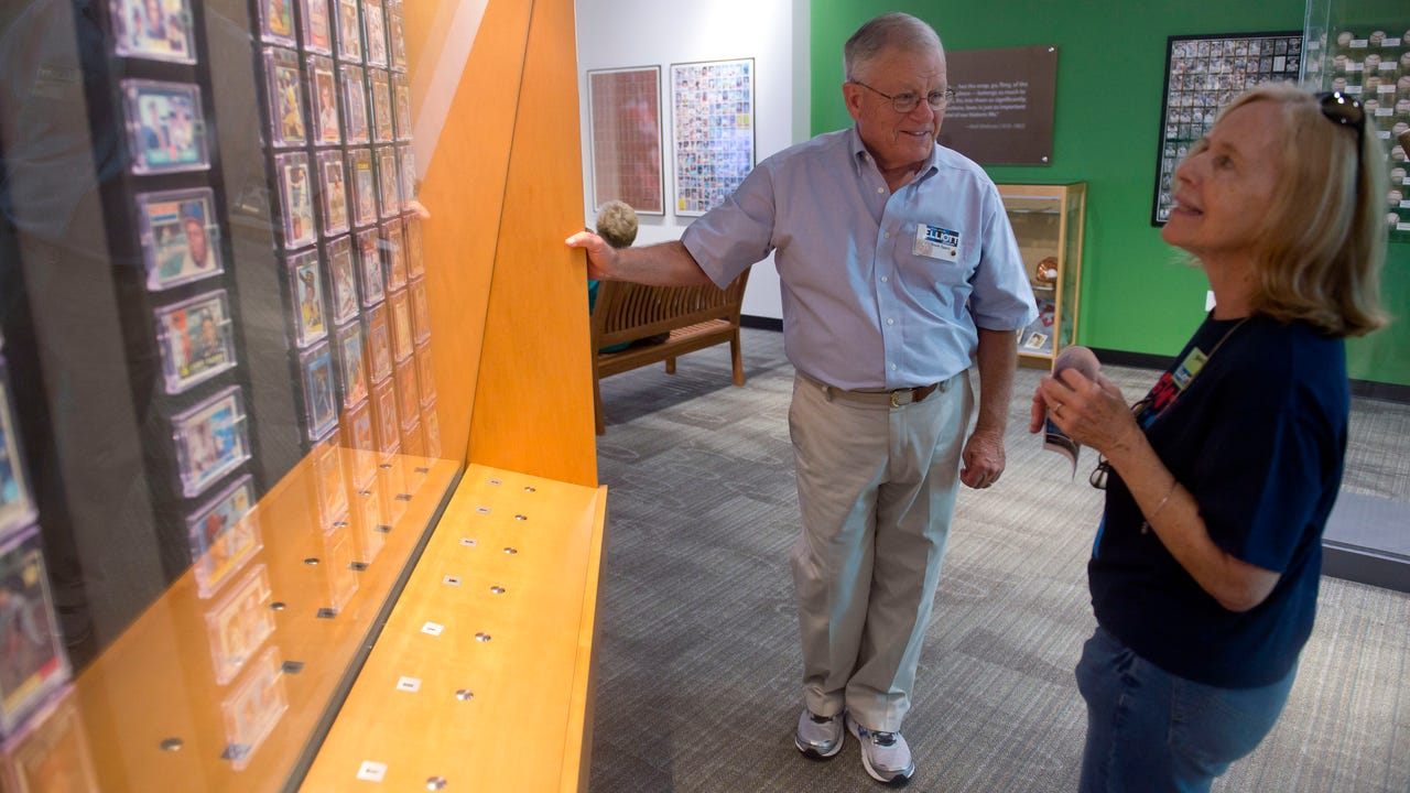 Frank Spera, an enthusiastic baseball fan who grew up in Brooklyn in the 1950s, volunteers his time on Thursdays and Sundays to teach guests about the vintage baseball cards and other memorabilia at the Baseball Gallery at The Elliott Museum.