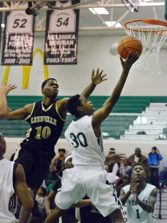 ANI Peabody vs. Leesville Peabody's Cedric Russell (30, right) scores two over Leesville's Deshawn Lewis (10, left) Friday, Jan. 16, 2015.-Melinda Martinez/mmartinez@thetowntalk.com
