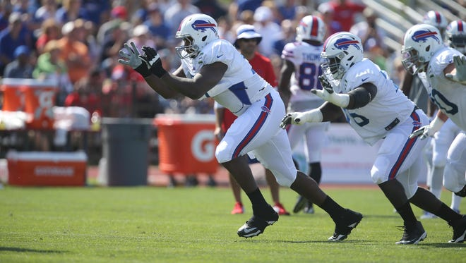 Bills Cyrus Kouandjio breaks off the line in a blocking drill at training camp.