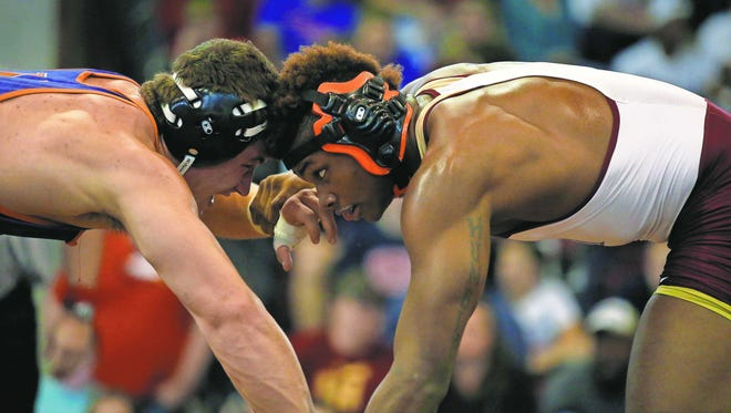 Florida High's Cam Brown and Valwood's Gahnon Byington wrestle in the Seminole Wrestling Classic at Florida High on Saturday. Brown captured the 195-pound weight class title.